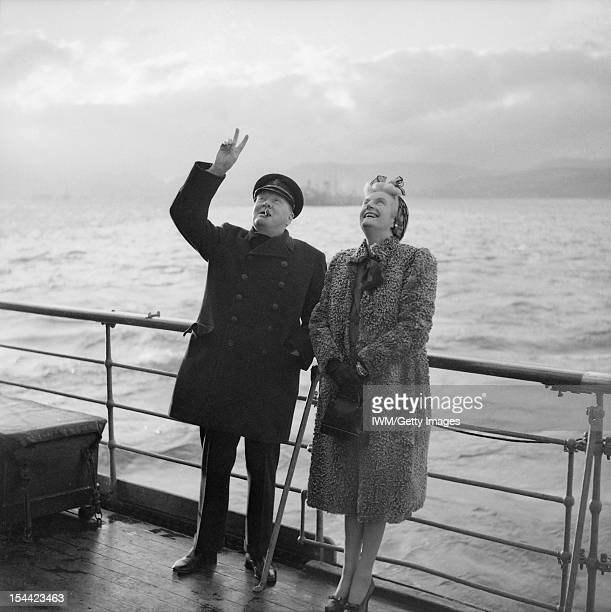 The Royal Navy During The Second World War Prime Minister Winston Churchill gives the 'V' sign in reply as troops cheer him when he left the QUEEN...