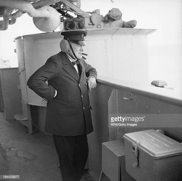 The Royal Navy During The Second World War The Prime Minister Winston Churchill wearing leather earguards watching gunnery practice on board HMS...