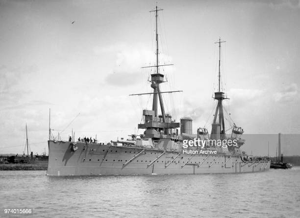 The Royal Navy Invincibleclass battlecruiser HMS Indomitable of the1st Cruiser Squadron in August 1908 at Fairfield Shipbuilding Engineering Co Ltd...