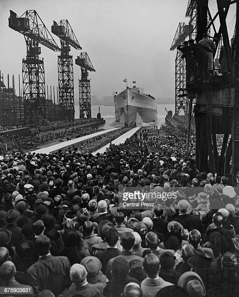 The Royal Navy King George Vclass battleship HMS Prince of Wales shortly after being launched down the slipway by Princess royal Princess Mary...