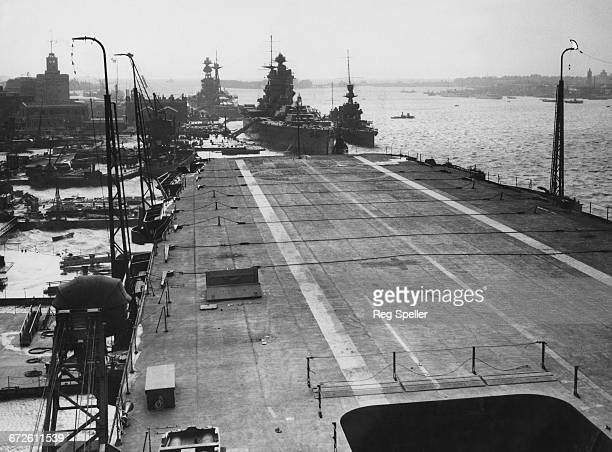 The Royal Navy Nelsonclass battleship HMS Rodney and the Revengeclass battleship HMS Royal Oak can bee seen tied up at anchor as viewed from the flat...