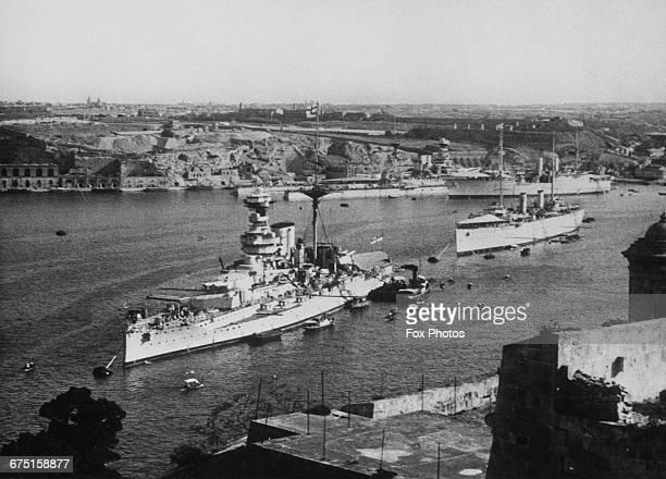 The Royal Navy Queen Elizabethclass dreadnought battleship HMS Queen Elizabeth of the Mediterranean Fleet arrives at the Grand Harbour of the bomb...