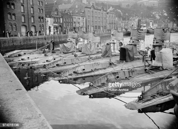 The Royal Navy's first Britishdesigned submarines the Aclass submarines of HM A8 A6 A10 A9 A12 A5 A11 and A7 moored together in Dover harbour in June...