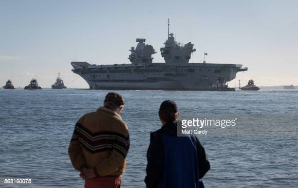The Royal Navy's newest aircraft carrier HMS Queen Elizabeth departs Portmouth dockyard on October 30, 2017 in Portsmouth, England. Crowds of people...