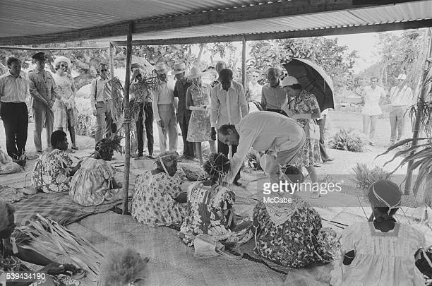 The royal party meets local people during a visit to Port Vila, Vanuatu, off the north-east coast of Australia, February 1974. On the right are Queen...