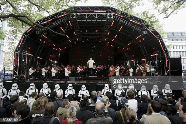 The Royal Philharmonic Orchestra performs the score to Star Wars in Leicester Square as fans celebrate the London premiere of the final part of the...