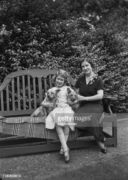 The Royal Princess Elizabeth with her mother Elizabeth BowesLyon and their Pembroke Welsh Corgi dogs Dookie and Jane at her home at 145 Piccadilly...
