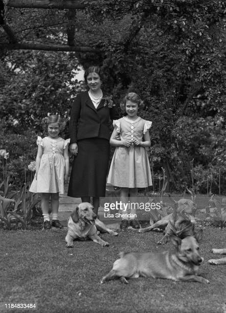 The Royal Princesses Margaret and Elizabeth with their mother Elizabeth BowesLyon and their dogs at the Royal Lodge Windsor UK June 1936