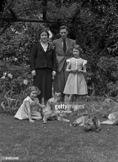 The Royal Princesses Margaret and Elizabeth with their mother Elizabeth BowesLyon and father Albert Duke of York with their dogs including Pembroke...