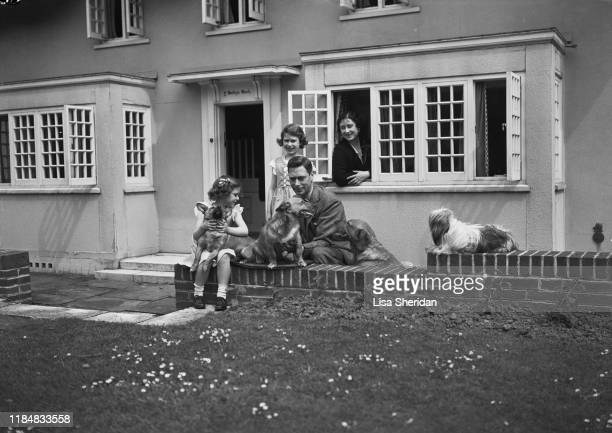 The Royal Princesses Margaret and Elizabeth with their mother Elizabeth BowesLyon and their father Albert Duke of York with their dogs including...