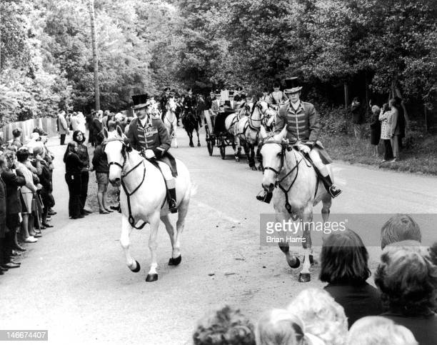 The royal procession approaches the Golden Gates at Ascot after driving through Windsor Great Park and Cheapside village 21st June 1972