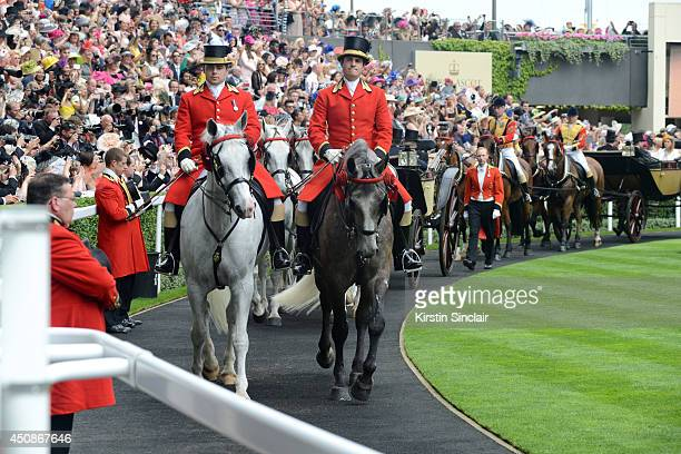 The Royal Procession arrives to the Parade Ring during day three of Royal Ascot at Ascot Racecourse on June 19 2014 in Ascot England