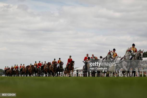The Royal procession make their way down the course on day 4 of Royal Ascot at Ascot Racecourse on June 23 2017 in Ascot England