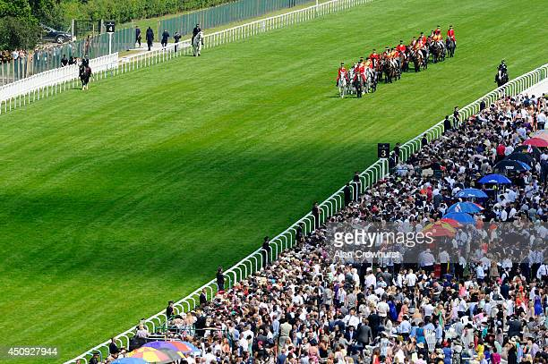 The Royal Procession makes its way along the race track during day four of Royal Ascot 2014 at Ascot Racecourse on June 20 2014 in Ascot England