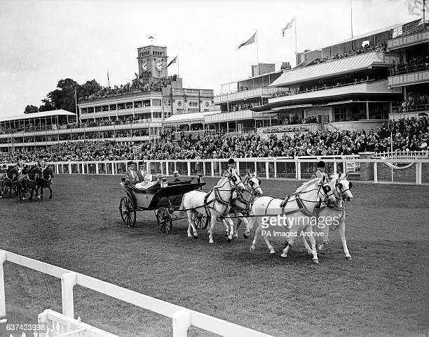 The royal procession makes its way down the Ascot course