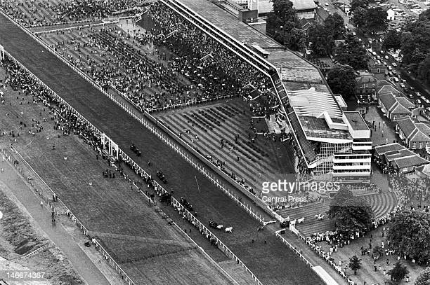 The royal procession on the course at Ascot, 19th June 1969. The Queen's coach is seen turning into the paddock.