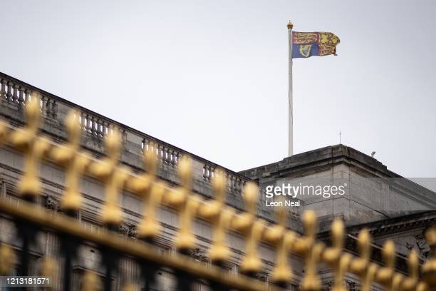 The Royal Standard flies above Buckingham Palace on the day that Queen Elizabeth II is set to move to Windsor Palace in a bid to avoid the COVID-19...