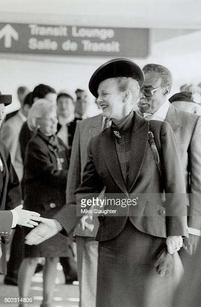 The Royal touch Queen Margrethe II of Denmark greets wellwishers at Pearson International Airport yesterday tralled by Ontario LieutenantGovernor...