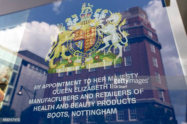 The royal warrant for Boots the chemist is displayed in the window of their Oxford Street branch on August 6 2014 in London England US pharmacy chain...