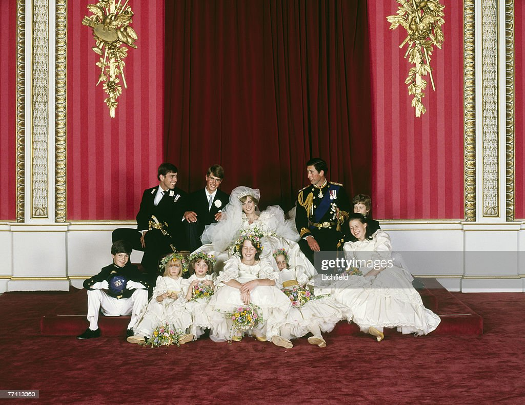 The Royal Wedding Group relaxed after the formal shots in the Throne Room at Buckingham Palace on 29th July 1981 with the bride and bridegroom, TRH The Prince and The Princess of Wales, in the centre. Front row (left to right) Mr Edward van Cutsem, Miss Clementine Hambro, Miss Catherine Cameron, Miss India Hicks, Miss Sarah-Jane Gaselee, Lady Sarah Armstrong-Jones. Second row (left to right) HRH The Prince Andrew, HRH The Prince Edward, Lord Nicholas Windsor. (Photo by Lichfield/Getty Images).
