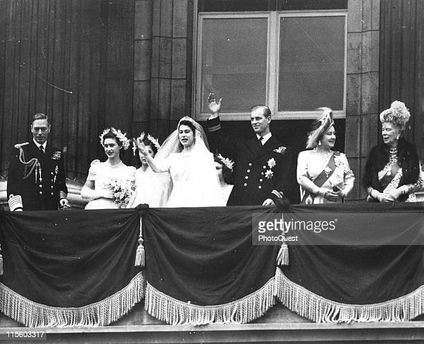 The Royal Wedding Party wave from the balcony of the Buckingham Palace, London, England, November 20, 1947. Front row, from left, King George VI ,...