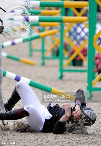 The Royal Windsor Horse Show Windsor Great Park UK Tim Stockdale Falls off Fresh Direct moments after winning the Land Rover Six Bar jumping...