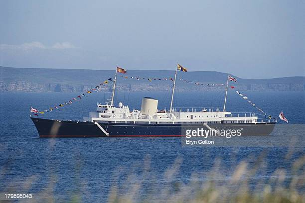 The Royal Yacht Britannia lies at anchor of the port of Scrabster as members of the Royal family disembark to visit the Queen MotherÕs highland...