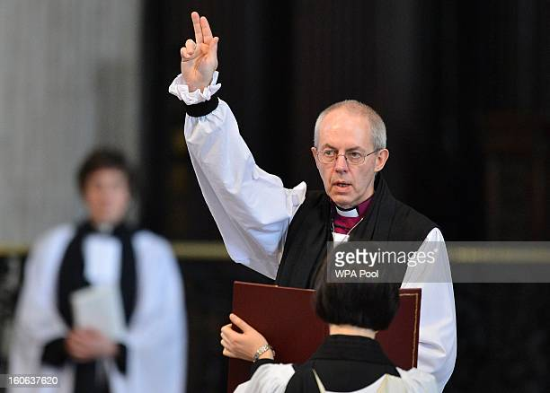 The Rt Revd Justin Welby gives a blessing at the close of the ceremony to confirm his election as Archbishop of Canterbury at St Paul's Cathedral on...