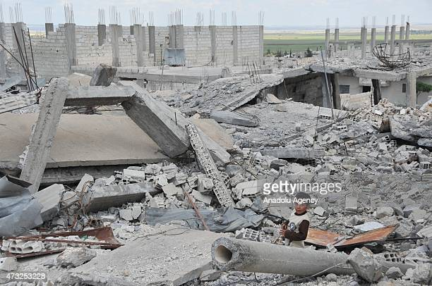The rubble of buildings destroyed in the clashes between DAESH militants and Kurdish armed groups are seen in the center of the Syrian town of Kobani...
