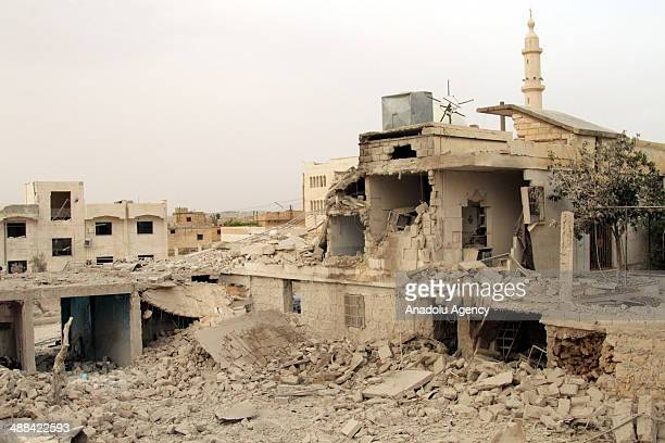 The rubble of houses destroyed in Syrian government air strikes is seen in the village of Anadan north of in Aleppo Syria on May 06 2014