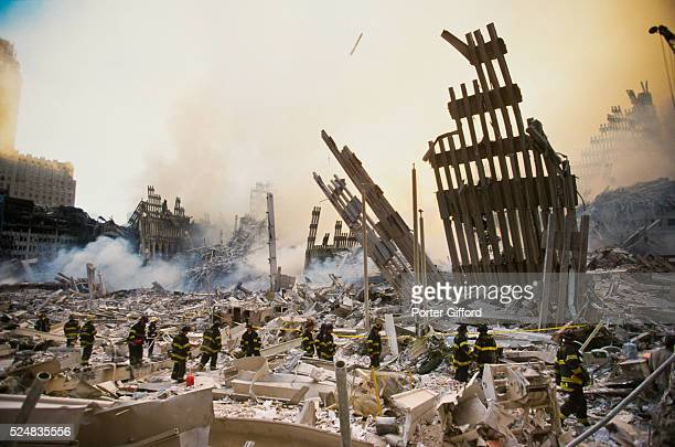 The rubble of the World Trade Center smoulders following a terrorist attack September 11, 2001 in New York. A hijacked plane crashed into and...