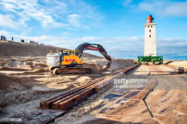 The Rubjerg Knude lighthouse is seen during preparations for its translocation, in Rubjerg, Jutland, Denmark, on October 21, 2019. - The construction...