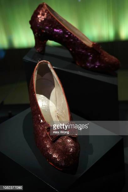 """The """"ruby slippers"""" which Judy Garland wore during the 1939 filming of The Wizard of Oz are put on display during a press preview for the exhibit..."""
