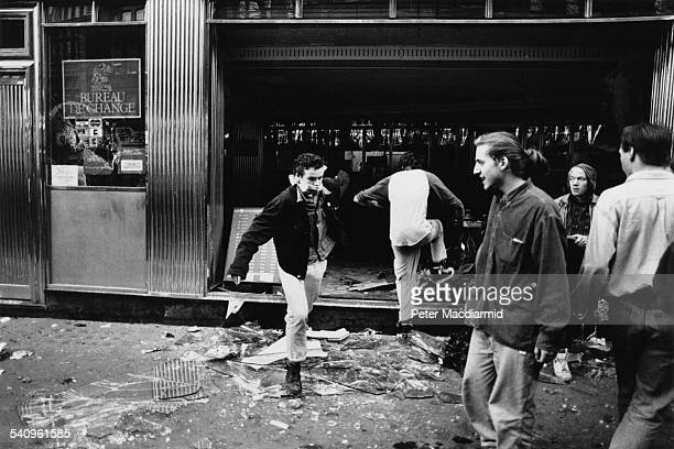 The ruined frontage of Barclays Bank on Charing Cross Road during the Poll Tax Riots in London 31st March 1990