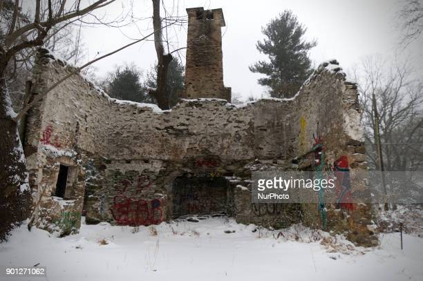The ruined remains of a cottage sits in a snow covered meadow in Northwest section of Philadelphia PA as the region braces for the 'Bomb Cyclone'...