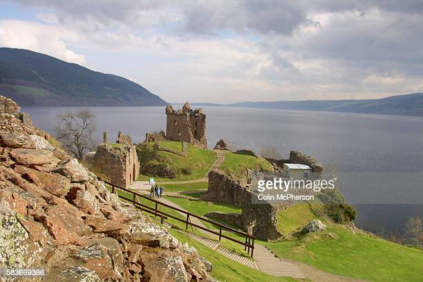 The ruined Urquhart Castle towering over the western shore of Loch Ness at Drumnadrochit The loch is famed for the mythical monster Nessie which has...