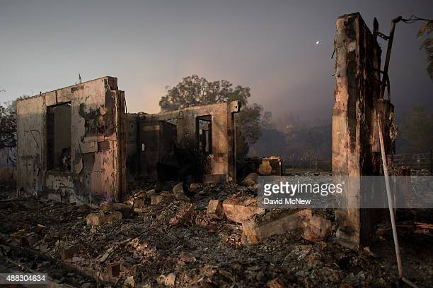 The ruins of a home that burned in the Valley Fire are seen on September 15 2015 in Middletown California The 104squaremile fire is only 15 percent...