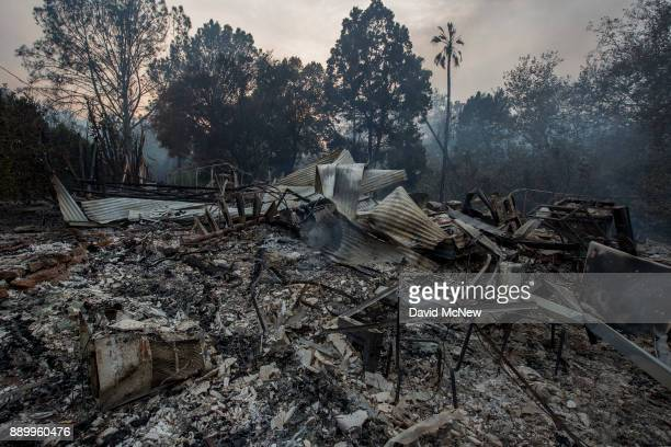 The ruins of a house that was destroyed by the Thomas Fire are seen on December 10 2017 near Carpinteria California The Thomas Fire has grown to...