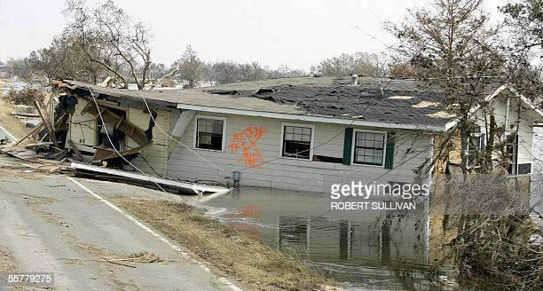 The ruins of a house washed up on highway 27 in the southwestern costal town of Creole LA 26 September 2005 Rescue helicopters scoured flooded areas...