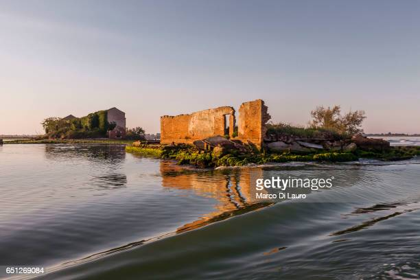 The ruins of an abandoned house are seen on the Venice Lagoon from the ferry going to Burano Island on July 1 2015 in Venice Italy According to...