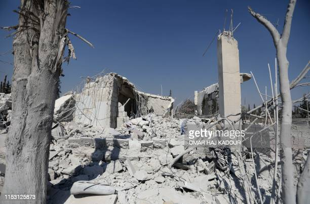 The ruins of buildings are pictured on July 1 2019 at the site where the US military carried out a strike against AlQaedalinked jihadists in Syria's...