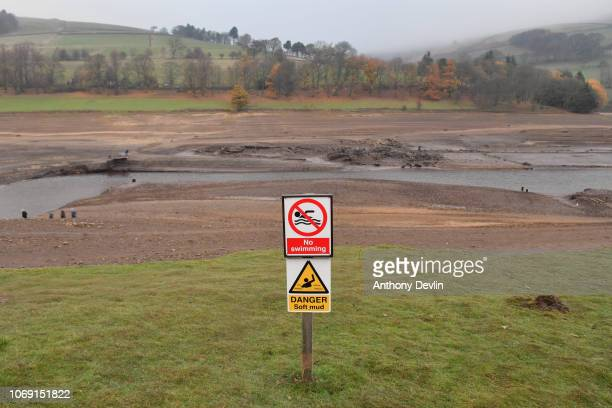 The ruins of Derwent Hall are exposed by low water levels in Ladybower reservoir on November 18, 2018 in Sheffield, England. The villages of Derwent...