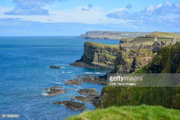 the ruins of dunluce - dunluce castle stock photos and pictures