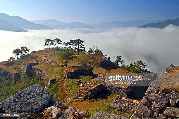 The ruins of former Takeda Castle is covered with sea of clouds on October 31 2006 in Asago Hyogo Japan