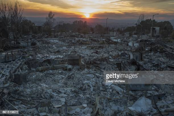 The ruins of houses destroyed by the Tubbs Fire are seen near Fountaingrove Parkway on October 14 2017 in Santa Rosa California At least 40 people...