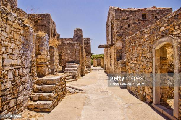 the ruins of spinalonga island - goose bumps stock pictures, royalty-free photos & images