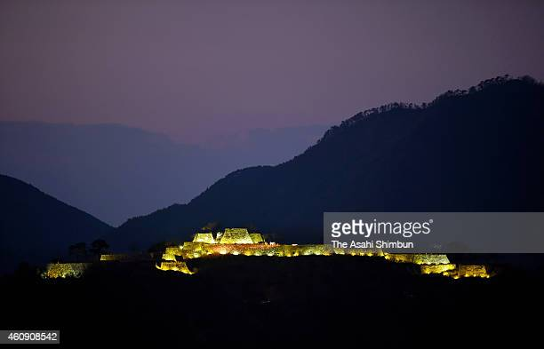 The ruins of Takeda Castle are illuminated during a trial lighting show on December 29 2014 in Asago Hyogo Japan Eightyseven lightemitting diode...