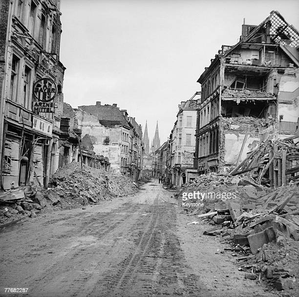 The ruins of the city of Cologne following heavy bombing by the Allies during World War II 1945 The city's famous cathedral is visible in the distance