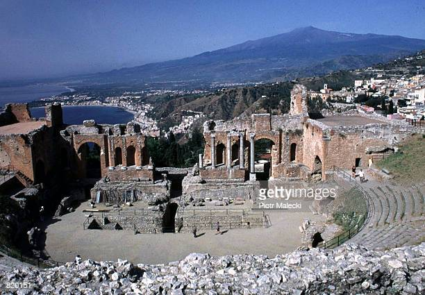 The ruins of the famous Greek theater in Taormina Sicily Italy is seen with the Etna Volcano in the background May 1999
