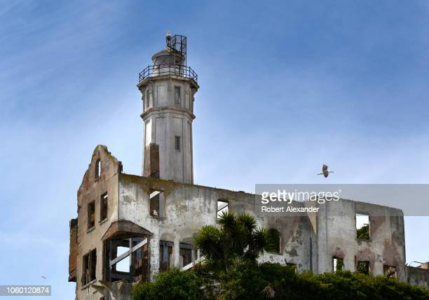 SAN FRANCISCO CALIFORNIA SEPTEMBER 12 2018 The ruins of the Warden's House stand beside Alcatraz Island Lighthouse at the former Alcatraz Federal...